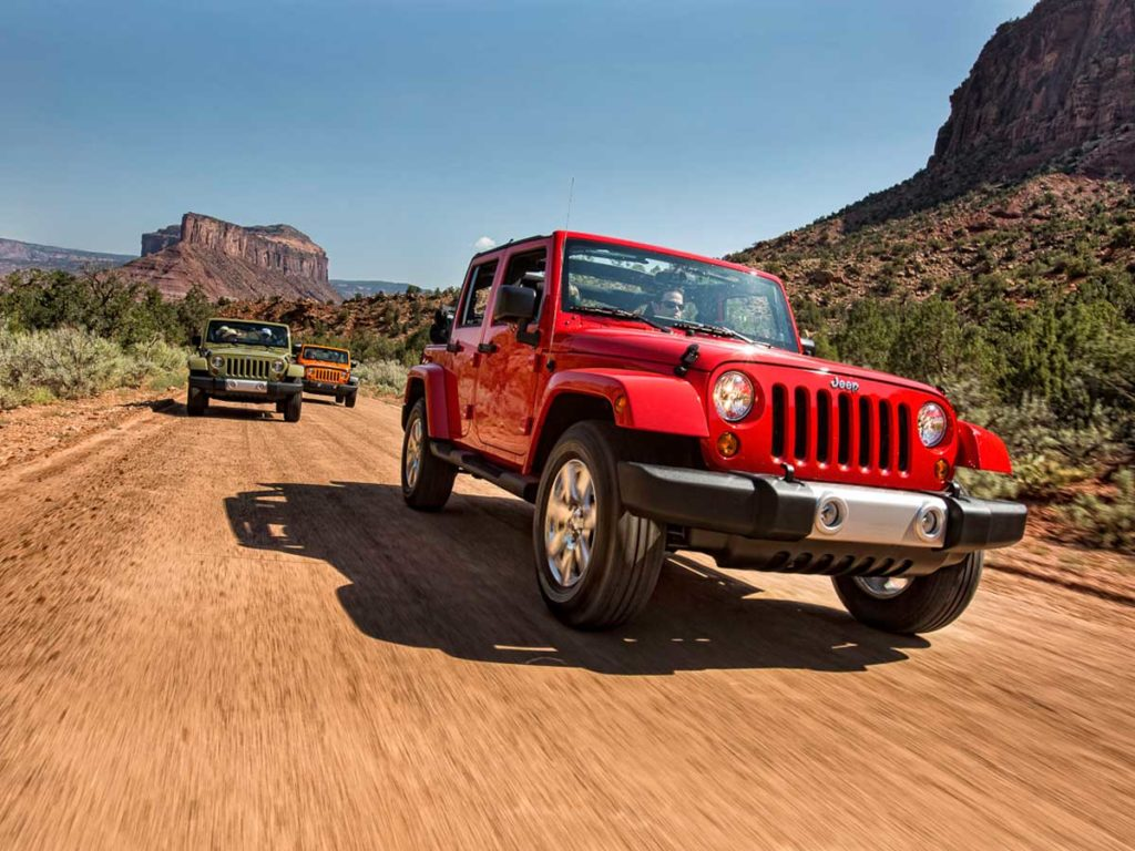 Jeep racing down road near Gateway Canyons Resort