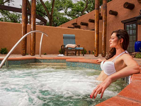 woman in hot tub at Gateway Canyons Resort